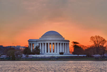 Jefferson Memorial at dawn by Tidal Basin and surrounded by pink Japanese Cherry blossoms Stock Photo - 9182367