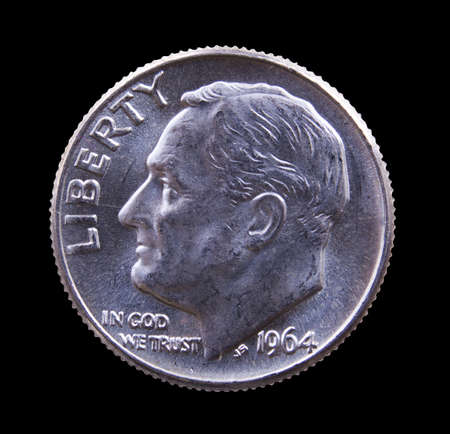 Pre 1964 dimes were 90% pure silver and are collectible. A good example of a Roosevelt dime isolated against black photo
