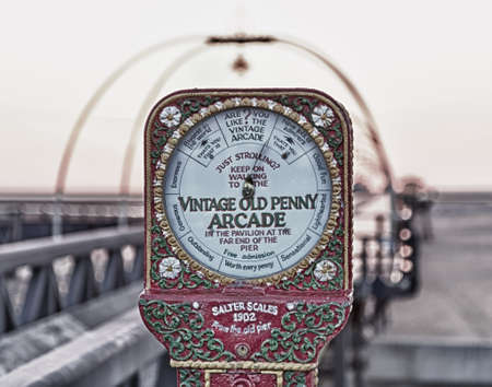 Antique scales on entrance to Southport Pier in Lancashire, England