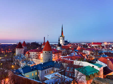 glows: Capital of Estonia, Tallinn is famous for its World Heritage old town walls and cobbled streets. The old town is surrounded by stone walls and distinctive red roofs and glows at dusk