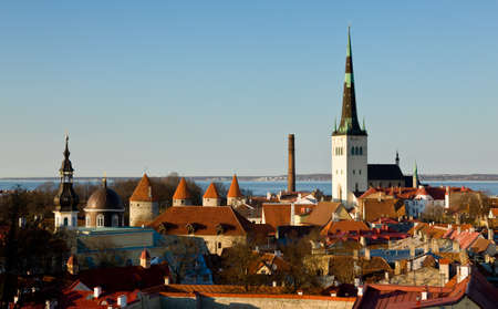 cobbled: Capital of Estonia, Tallinn is famous for its World Heritage old town walls and cobbled streets. The old town is surrounded by stone walls and distinctive red roofs Stock Photo