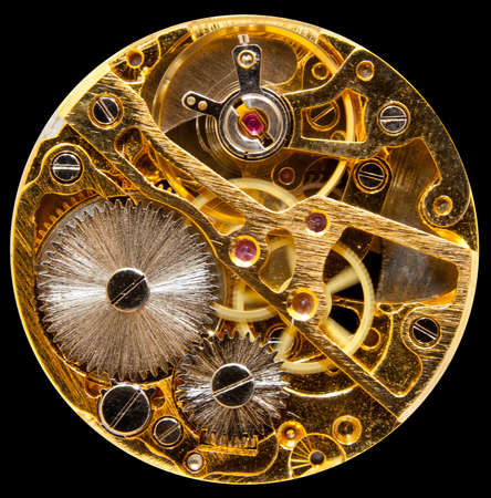 Macro shot of the interior of an old pocket watch with a hand-wown mechanical movement photo