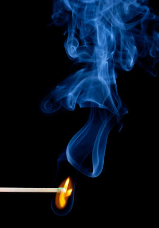 matchstick: Green coated match head starts to burn with light blue smoke