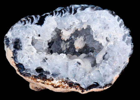 Macro image of a geode rock with the crystalline shapes inside the geode clearly visible and in focus