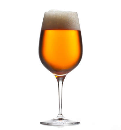 Chilled isolated wine goblet with small droplets of condensation on the outside of the glass and filled with golden colored beer Stock Photo - 10960647