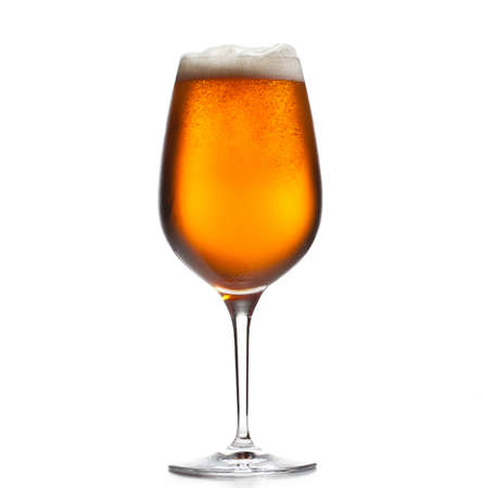 chilled: Chilled isolated wine goblet with small droplets of condensation on the outside of the glass and filled with golden colored beer Stock Photo