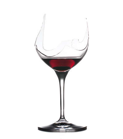 Red wine in a broken wine glass isolated against white