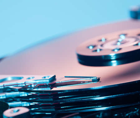 Magnetic disc inside a computer hd unit showing mirror surface of the magnetic discs and read write head Stock Photo - 10960675