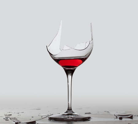 Red wine in a broken wine glass with a partial extraction path saved in the file