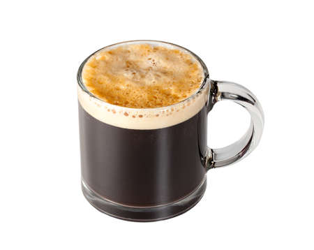 brewed: Black expresso coffee with heady froth in a glass mug or cup with path around the edge