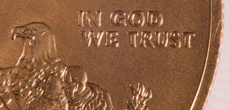 ounce: Gold Eagle one ounce coins with macro shot of the engraving of In God We Trust Stock Photo