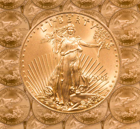 ounce: Gold Eagle one ounce coins in a patterns and stacked on each row with a single Liberty coin on the top