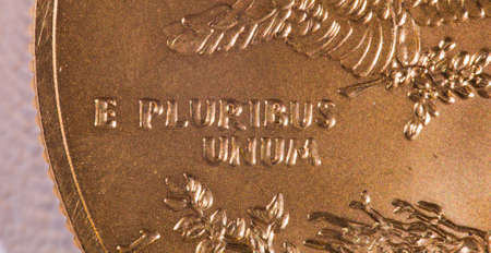 pluribus: Gold Eagle one ounce coins with macro shot of the engraving of E Pluribus Unum Stock Photo