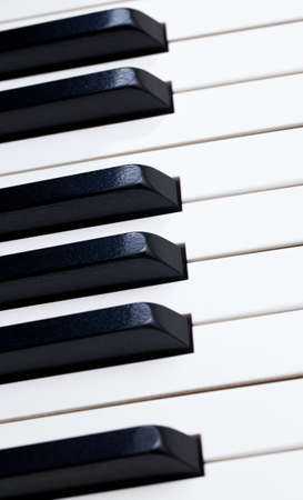 Close up image of the keys of a grand piano