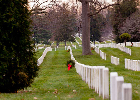 military cemetery: Christmas wreaths on gravestones in Arlington National Cemetery. The wreathes have been donated each year since 1992. Editorial