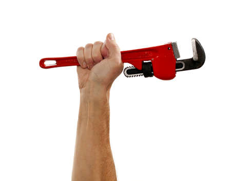 Senior male holding a large red wrench isolated against white photo