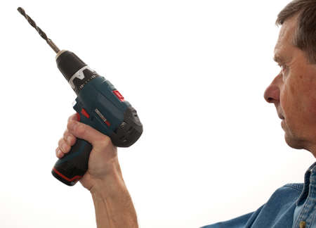 Senior male holding a power drill isolated against white Stock Photo - 11781801