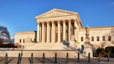 Late afternoon winter sun illuminates front of supreme court in Washington in winter photo