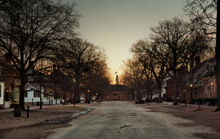 WILLIAMSBURG, VIRGINIA - DECEMBER 30: Sun rises over the Capitol on December 30, 2011. Colonial Williamsburgs 301 acres includes many restored buildings and houses