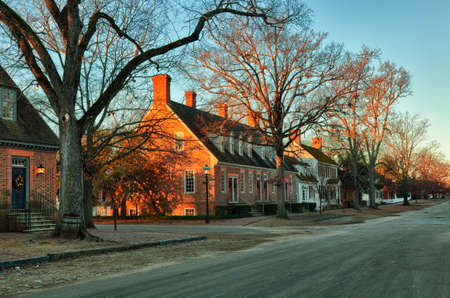 WILLIAMSBURG, VIRGINIA - DECEMBER 30: Sun rises over the restored houses on December 30, 2011. Colonial Williamsburgs 301 acres includes many restored buildings and houses
