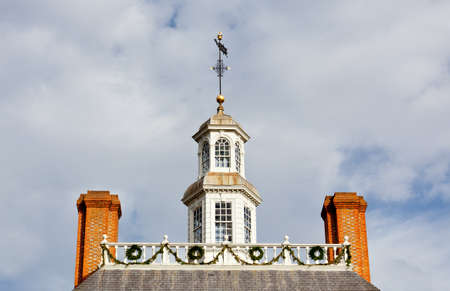 crown spire: WILLIAMSBURG, VIRGINIA - DECEMBER 30: Roof of Governors Palace decorated for xmas on December 30, 2011. Colonial Williamsburgs 301 acres includes many restored buildings and houses