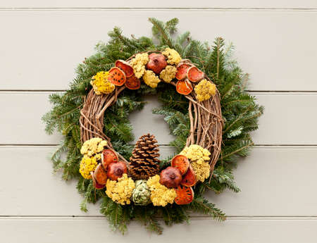 colonial: Traditional design of a christmas wreath attached to the front door of old house