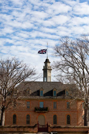WILLIAMSBURG, VIRGINIA - DECEMBER 30: British flag flies over the Capitol on December 30, 2011. Colonial Williamsburgs 301 acres includes many restored buildings and houses