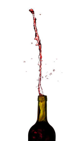 Red wine being poured directly upwards from bottle