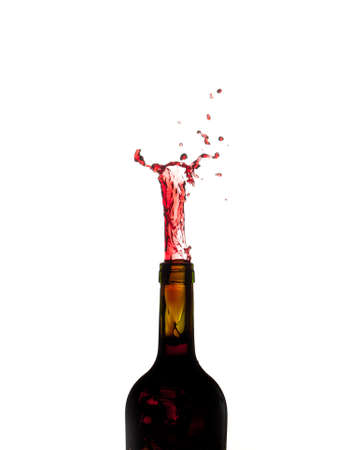 erupt: Red wine being poured directly upwards from bottle