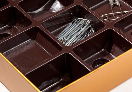 Home organizer for paper clips and staples from old chocolate liner in box Stock Photo - 11977484