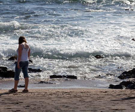 beachcombing: Woman beachcombing on Glass Beach in Kauai Stock Photo