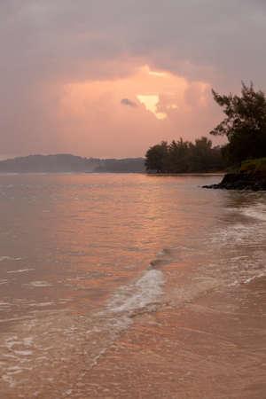 Sunrise on Anini beach with Kilauea lighthouse in the distance photo
