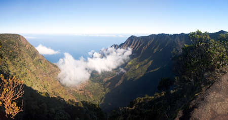 Panoramic low clouds start to form on Kalalau valley in Kauai Na Pali Coast Stock Photo