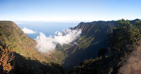 na: Panoramic low clouds start to form on Kalalau valley in Kauai Na Pali Coast Stock Photo