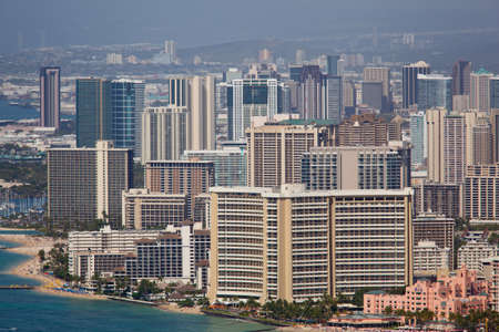 Tower blocks of Waikiki in Oahu Hawaii from the summit of Diamond Head crater photo