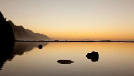 Albatros soaring over the Na Pali coast by Kee beach in Kauai at sunset photo