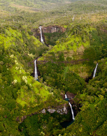 Kahili or Five Sisters waterfalls in the Hanapepe valley from air Stock Photo