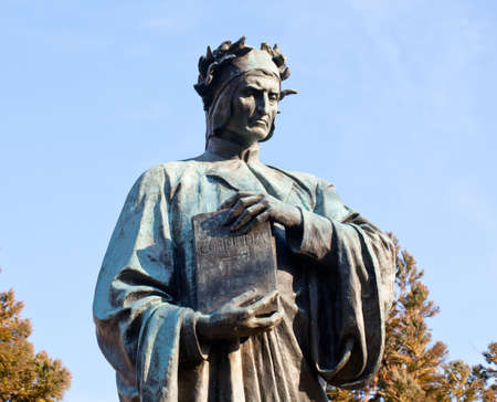 meridian: Statue of Dante holding Commedia book in Meridian Hill Park in Washington DC