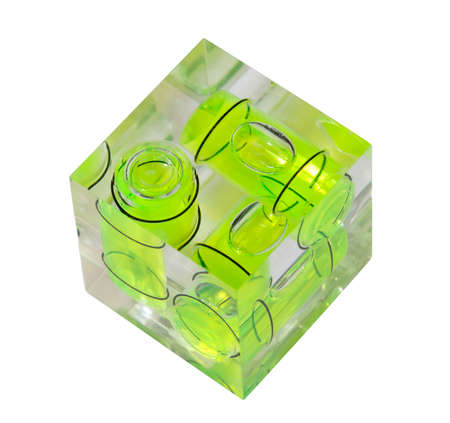perpendicular: Three green spirit levels in plastic cube setting angle in any direction Stock Photo