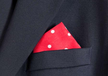 blazer: Folder linen handkerchiefs in red with white spots in top pocket of blazer Stock Photo
