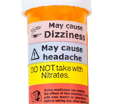 adverse reaction: Warning on prescription bottle about nitrates and erective disfunction tablets Stock Photo