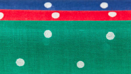 Folder linen handkerchiefs in red blue and green with white spots Stock Photo - 12451456