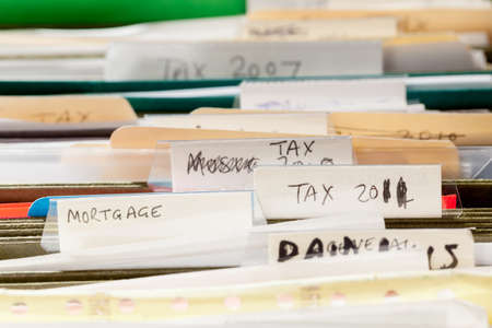 Folders in file drawer sorted into tax years and mortgage documents Stock Photo - 12783711