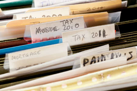 Folders in file drawer sorted into tax years and mortgage documents Stock Photo - 12783718