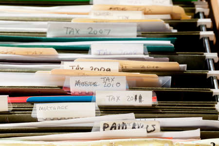 Folders in file drawer sorted into tax years and mortgage documents Stock Photo - 12783722