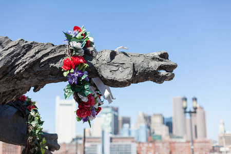 remembered: BOSTON, USA - MARCH 22: The Partisans Statue is decorated with a wreath for Polish war dead on March 19, 2012. The statue was sculpted by Andrew Pitynski Editorial