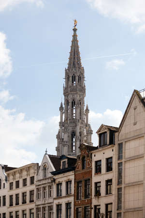 ornately: Ornate Brussels Town Hall in Grand Place over old and new buildings Stock Photo
