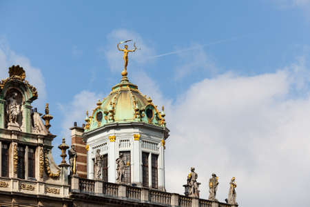 ornately: Detail of roof and gold statues on roof of Maison du Roi d Espagne in Grand Place Brussels
