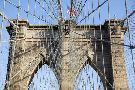 stone bridge: Detail of cables and wires on pier of Brooklyn Bridge in New York Stock Photo
