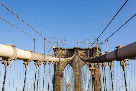 Detail of cables and wires on pier of Brooklyn Bridge in New York photo